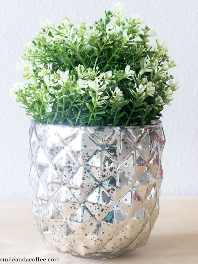 gold plant pot in entryway