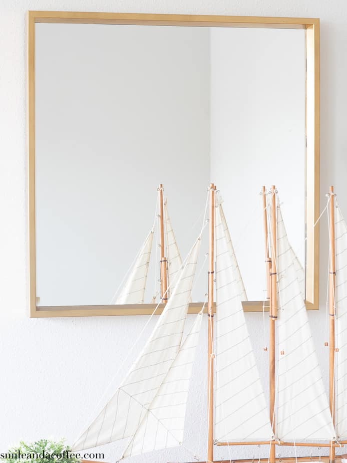 gold painted mirror in entryway