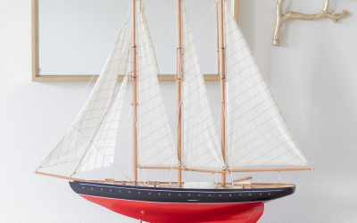 red sailboat in entryway