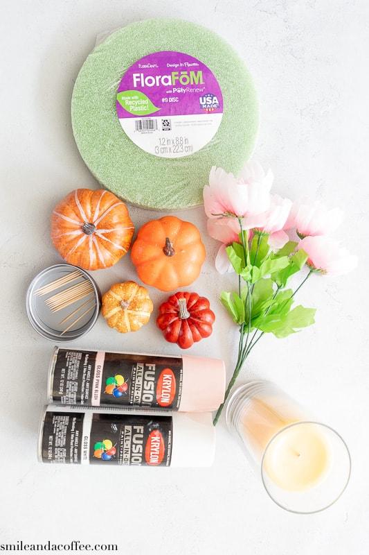DIY Fall center piece supplies. Pumpkins, flowers, foam base, vase, paint and candle