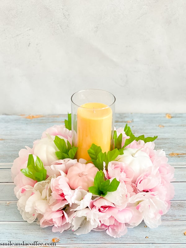 DIY Fall center piece with white and pink flowers and pumpkin, vase and a candle