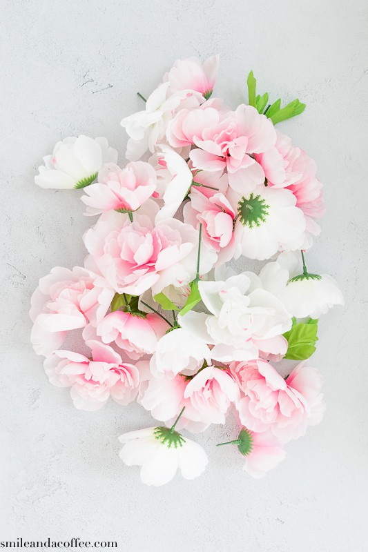white and pink faux peony flower stems cut for DIY
